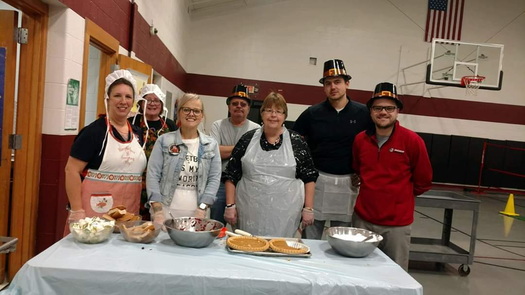 Staff serving the entire school a Thanksgiving meal
